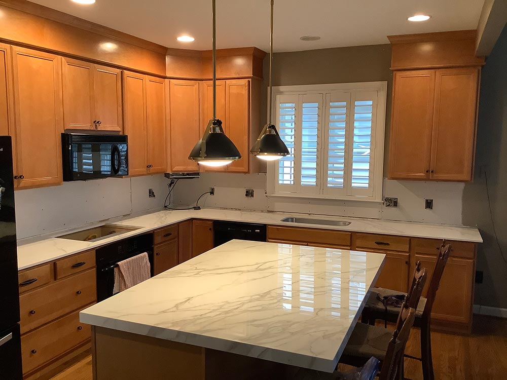 """Neolith Polished in 2cm Calacatta with 2"""" mitered Build Up on Island"""